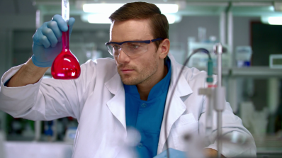 scientist-checking-test-tube-with-pink-liquid-scientist-doing-laboratory-research-laboratory-researcher-working-with-liquid-in-lab-worker-checking-glass-flask-in-chemical-lab-scientific-
